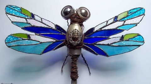 Photo of dragon fly made with wire and glass